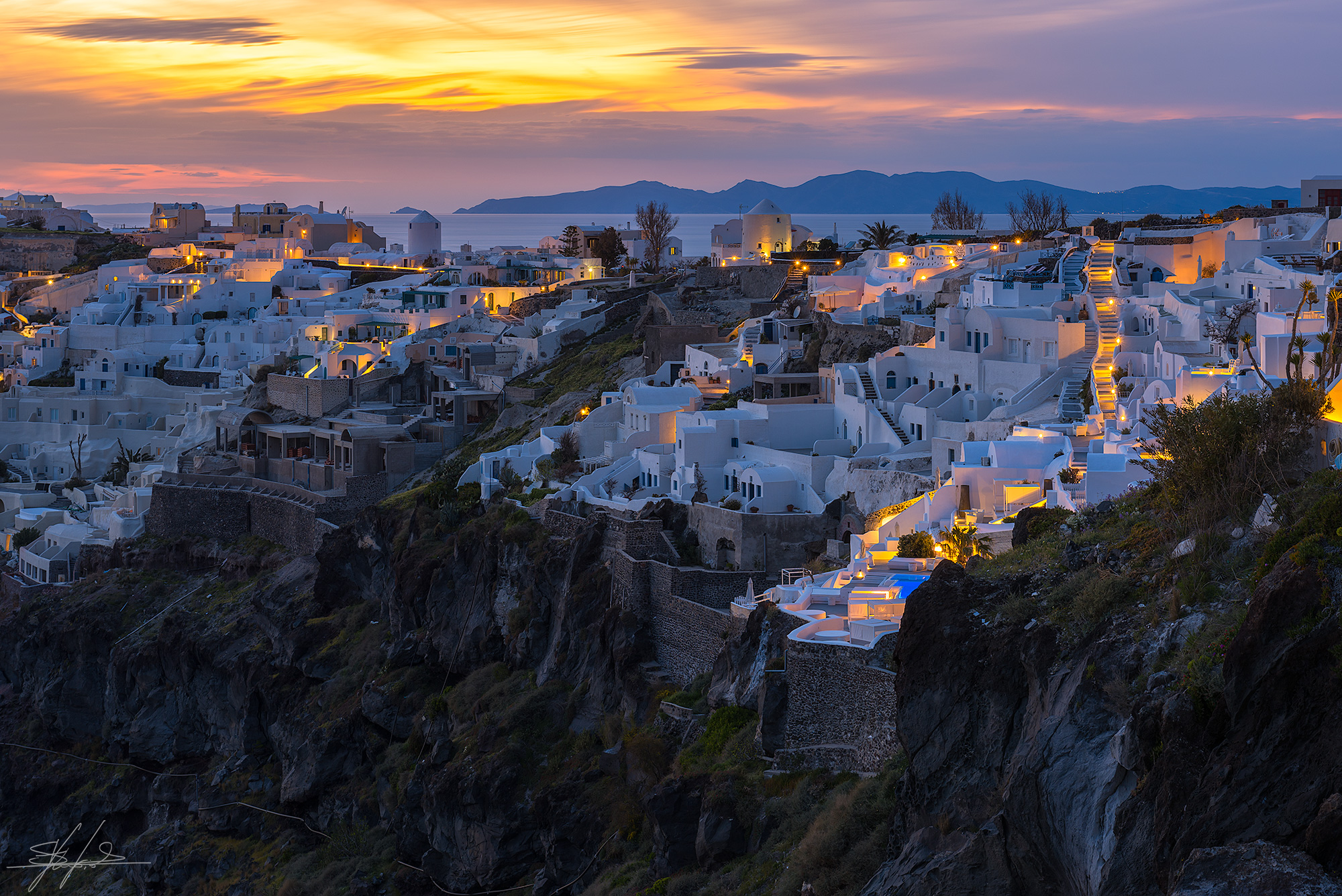 Oia lights at sunset